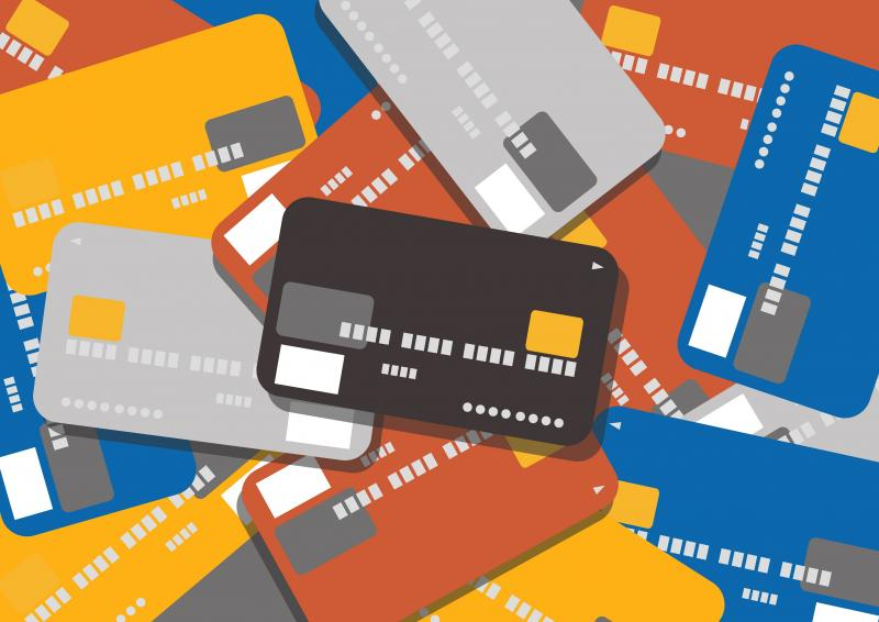 Mixed pile of credit cards, symbolizing disputing credit report errors, toolbox for consumers